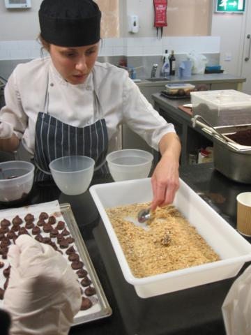 Our chef/tutor Lucy coating a truffle.  She's a great advert for apprenticeship schemes: passionate, professional and ambitious.