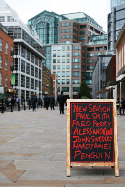 Chalkboard in front of Buildings - 'Where the East End Meets the Square Mile' taken outside Spitalfields Market, October 2008 Christina Owen