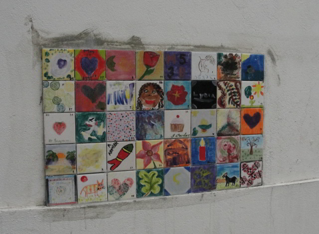 The mural of local children's decorated tiles. It's only going to get bigger