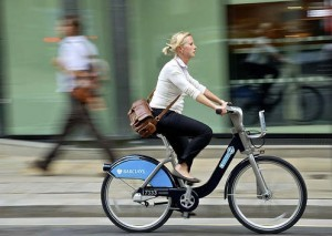 Woman riding Cycle Hire bike