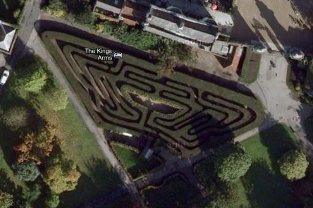 The famous Hampton Court Maze, with an unexpected pub in the top-left corner.