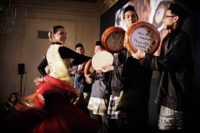 Dancers and drummers stir up excitement for the auction