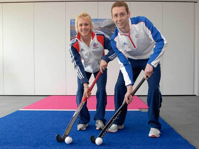 Alex Danson and Jonty Clarke launch the new blue Hockey pitch for London 2012. Image by Justin Setterfield for LOCOG.