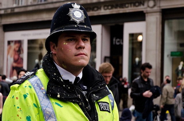 Paint-spattered policeman at Oxford Circus / paulµ43 from the Londonist Flickr pool