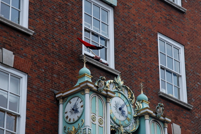 An anarchist flag waves from Fortnum and Mason at the start of the UK Uncut occupation / Tom Royal, with permission