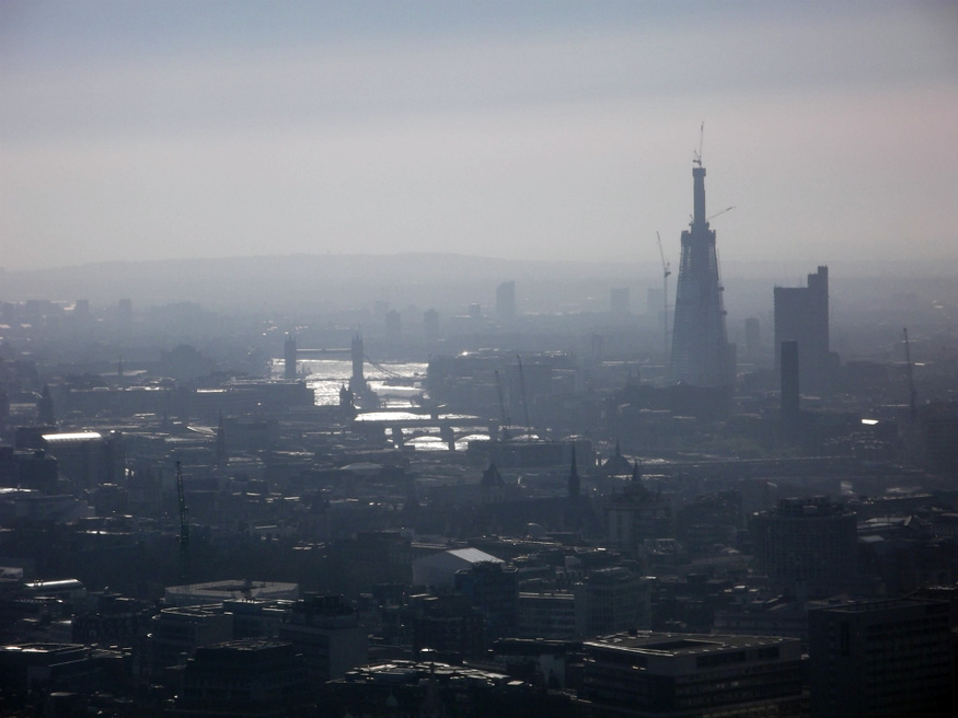 Looking south-east, the city smog enshrouds the Thames, and the ever-rising Shard.