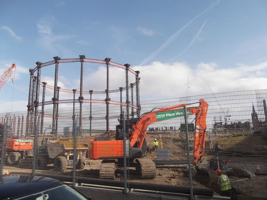 Sections of old gasometers, in storage at this site for years, are now being relocated for eventual reassembly.
