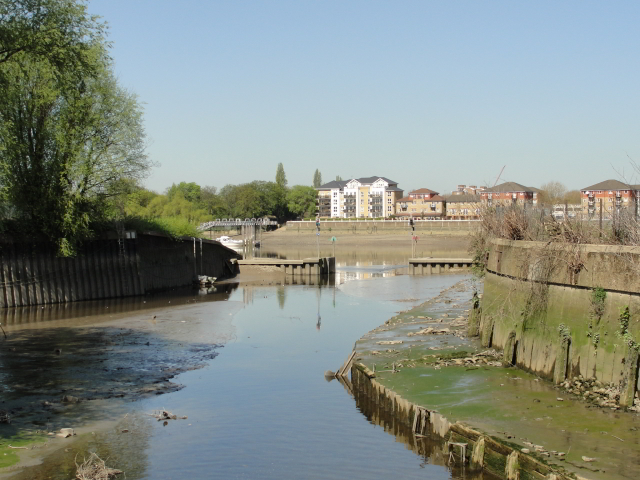 """p65: """"In the flat wall of the Thames embankment, hidden behind a flotilla of barges, a gap had appeared. 'This must be Wandle Creek,' said Napoleon."""""""
