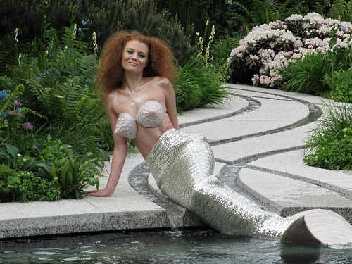 A mermaid lounges in the Homebase Cornish Memories Garden