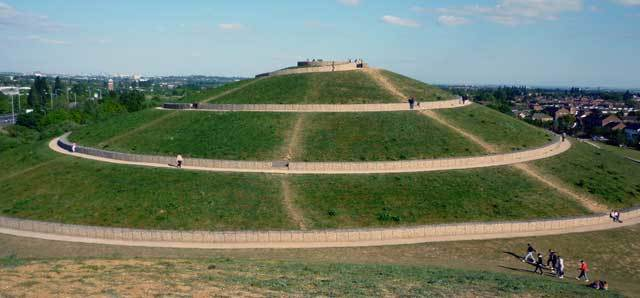The biggest mound is encircled by a spiral pathway, marked by walls built of crushed concrete in steel cages