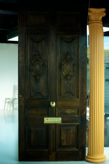 Original front door of the Savile Row premises sourced from salvage specialists, Lassco