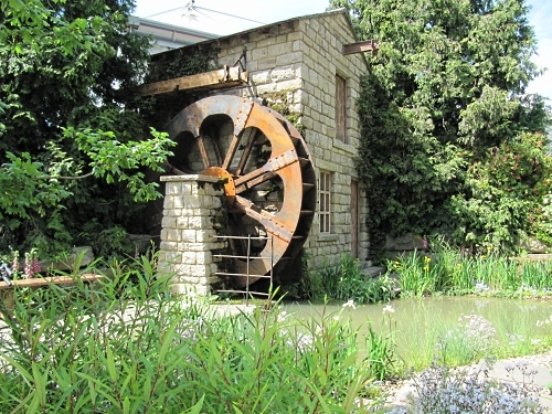 Water wheel and house in the HESCO Garden, which celebrates Leeds and water power