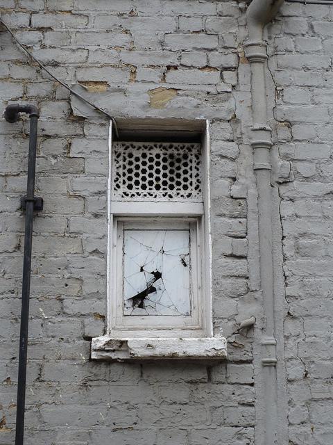 A very strange, eerie window in Bethnal Green.