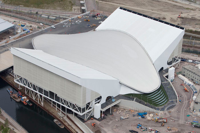 The building. The temporary spectator 'wings' to either side will be removed after the Olympics.