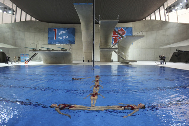 They're spelling out the number '1'. In the background are the diving boards.