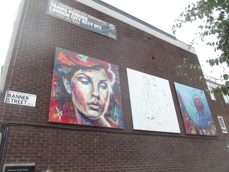 Panels of artwork line the street.