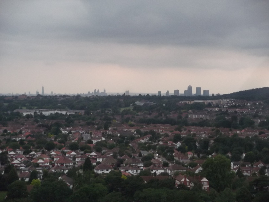 The far off city, with the Shard to the left, City at centre and Canary Wharf to the right. Shooters Hill looms to the extreme right.