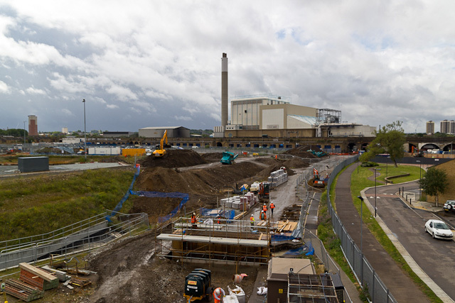View southwest from the top of the site office. The line diverts from the Surrey Quays to New Cross section of the existing East London line just behind the point from which this photo was taken. In the background is the SELCHP incinerator.