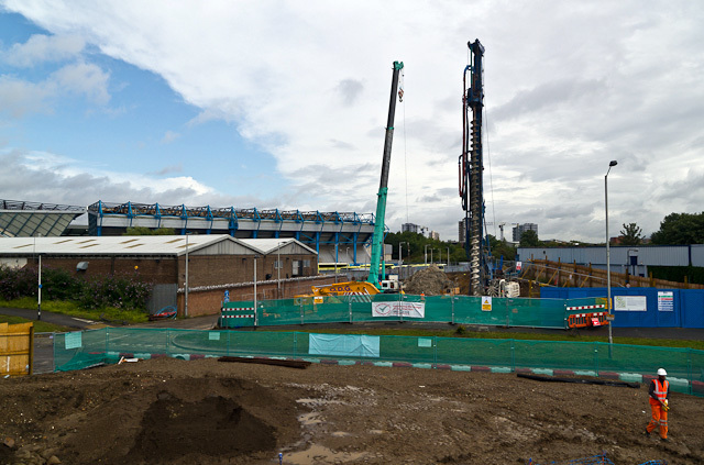 Putting in the piles for the bridge across Surrey Canal Road. In the background is Millwall's New Den stadium.
