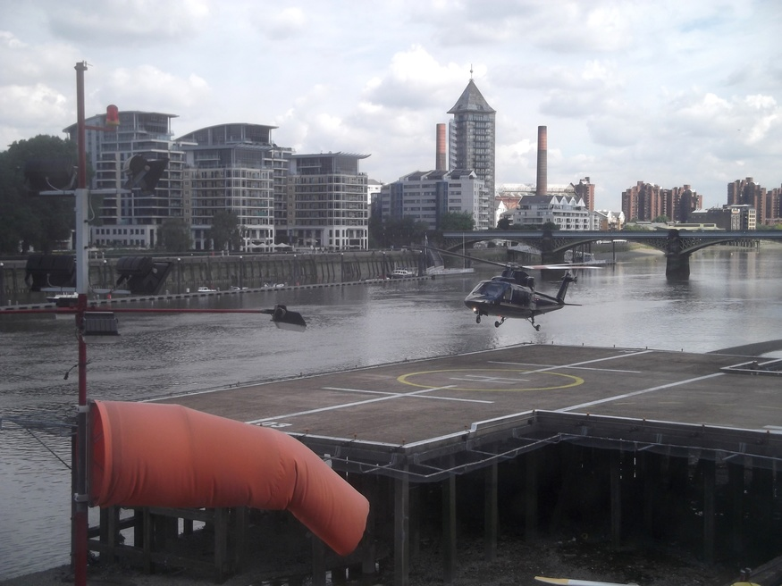 A helicopter landing at Battersea.