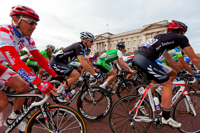 Riders cycle past Buckingham Palace by Mark Baynes