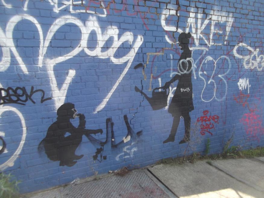 A hoarding stencil near Stratford High Street