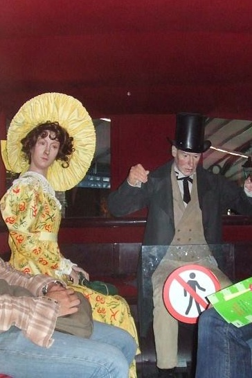 Which is more surreal? The flamboyant Edwardian transvestite on the left, or the worried-looking chap with the 'no men' sign over his groin? A world-beatingly odd exhibit at the London Transport Museum. Image by M@.
