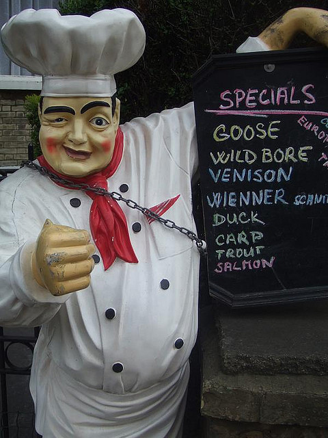 The Czech bar on West End Lane, West Hamstead, has an unusual gimmick to lure in customers in the form of this chained-up, gurning, fist-clenching Brian Clough lookalike. And check out the menu for a disturbing take on wild boar. Image by M@