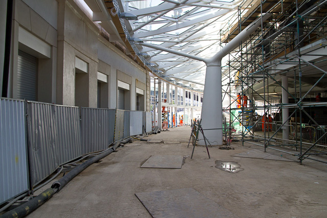 Ground level in the new concourse, with one of the 16 tree columns visible. To the left is a new entranceway underneath the Great Northern hotel