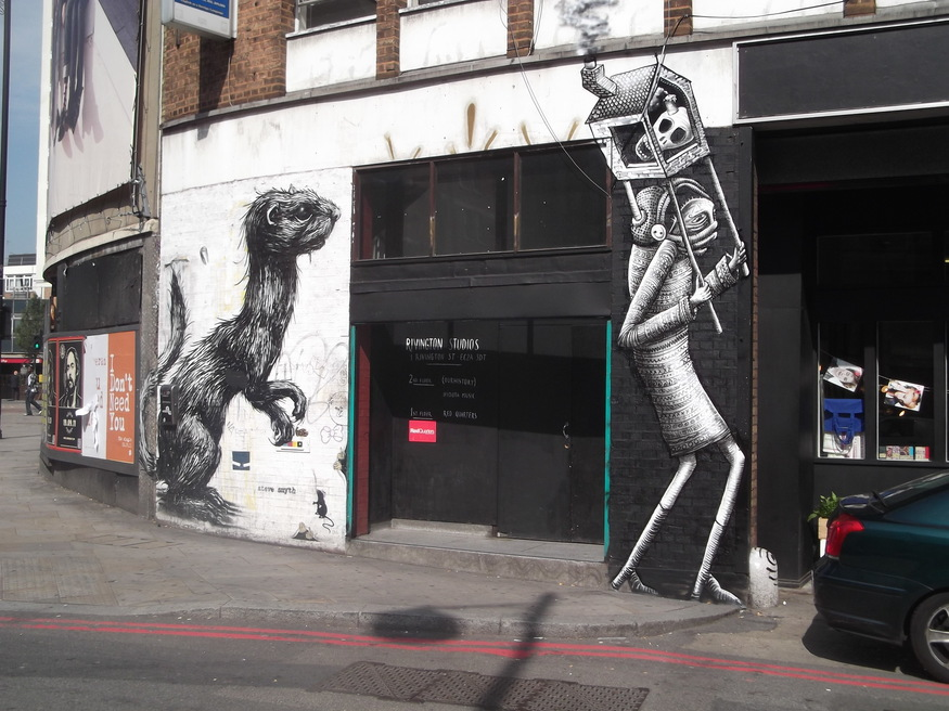 Phlegm's new piece (right) beside an old work by Roa.