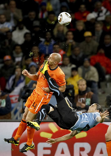 1st Prize Sport Single: Mike Hutchings, South Africa, for Reuters. Netherlands Demy de Zeeuw is kicked in the face by Uruguay's Martin Cáceres during World Cup semi-final, Cape Town, 6 July