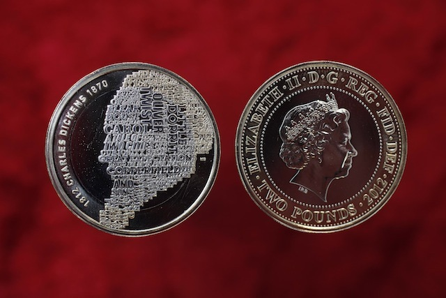 EMBARGOED TO 0001 MONDAY NOVEMBER 28. Royal Mint's new £2 coin featuring the image of Charles Dickens, which is comprised of the titles of his most famous novels, which has been created to celebrate 200th anniversary of his birth. PRESS ASSOCIATION Photo. Picture date: Wednesday November 9, 2011.  Photo credit should read: David Parry/PA