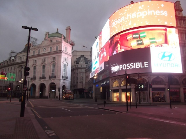 Piccadilly Circus lights with hardly anyone to see them.