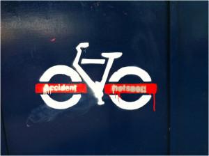Stencil graffiti of TFL bike with 'accident hotspot' written on it