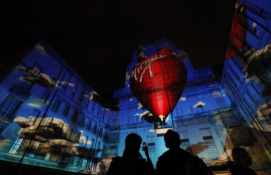 EMBARGOED TO 0001 WEDNESDAY JANUARY 11.  A  270 degree fully immersive 3D projection for Virgin Money appears at the University of London's Senate House Library courtyard to launch the company's '40 Years of Better. Now in a bank' campaign.  PRESS ASSOCIATION Photo. Picture date: Tuesday January 10, 2011. Virgin Group chairman Sir Richard Branson kicked off the three minute projection which told the Virgin story from space travel, trains, records, Virgin Atlantic planes and hot air balloons to a Virgin Money branch in front of audience of around 200.  Photo credit should read: David Parry/PA Wire