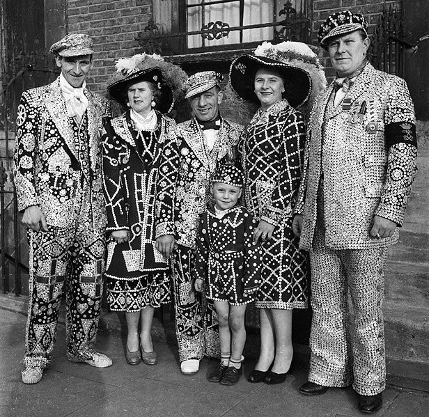 London Pearlies: 1955: Pearly Kings and Queens or East End costermongers in their traditional suits covered with pearl buttons (Photo by Peter Purdy/BIPs/Getty Images)
