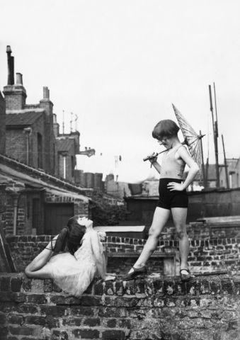 Back Garden Cabaret: Two young ballet dancers, Violet Hutchinson aged 8, and Betty Putt aged 7, rehearsing in a back garden in Poplar, east London. (Photo by Fox Photos/Getty Images)