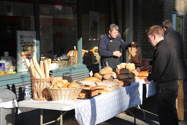 Selling bread in the sun down Borough Market way by Tim Woodall