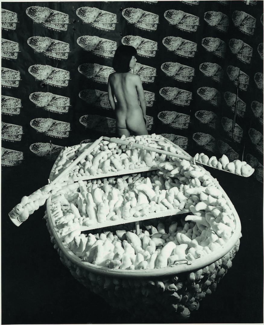 Kusama posing in Aggregation: One Thousand Boats Show 1963. Installation view, Gertrude Stein Gallery, New York. © Yayoi Kusama and © Yayoi Kusama Studios Inc