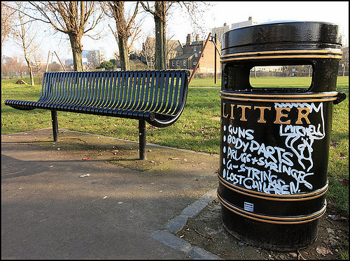 Sharing park space with amusing graffiti bin, by artofthestate