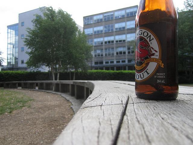 Bottle on a bench, by psyxjaw