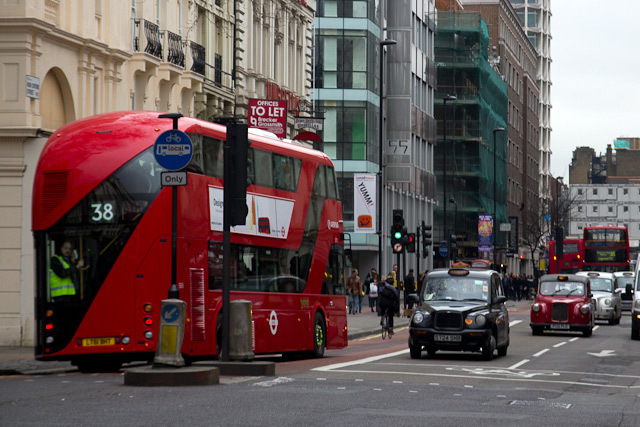 The bus moves off down New Oxford Street