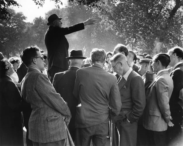 Speaker's Corner, Hyde Park, c.1950. Photographer: Bob Collins. Since 1872, Speakers' Corner has symbolised the British tradition of free speech where anyone can turn up unannounced and talk on practically any subject. © Estate of Bob Collins/Museum of London