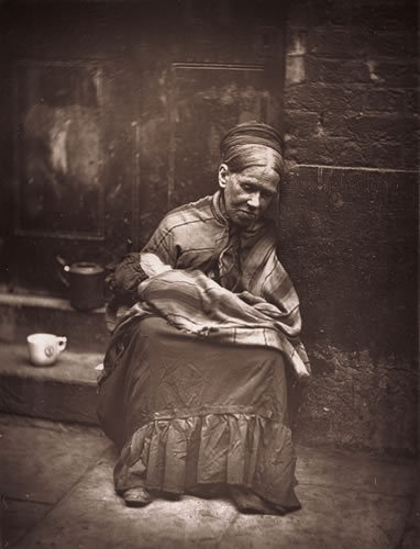 The Crawlers of St. Giles, 1877. Photographer: John Thomson. From a series called Street Life in London, this photograph shows a destitute woman minding the child of a friend who has found work for the day. © Museum of London