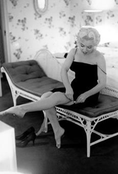 "Marilyn Monroe gets ready to go see ""Cat On A Hot Tin Roof"" in her hotel room on March 24, 1955 at the Ambassador Hotel in New York. Photo by Michael Ochs Archives/Getty Images"
