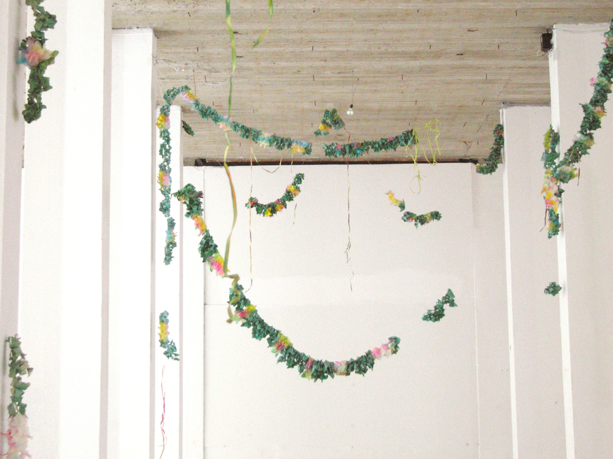 Amalia Pica, Final de Fiesta, (2005), colour photograph of paper garlands, installation view. Courtesy the artist, Gallery Diana Stigter, Amsterdam and Herald St, London