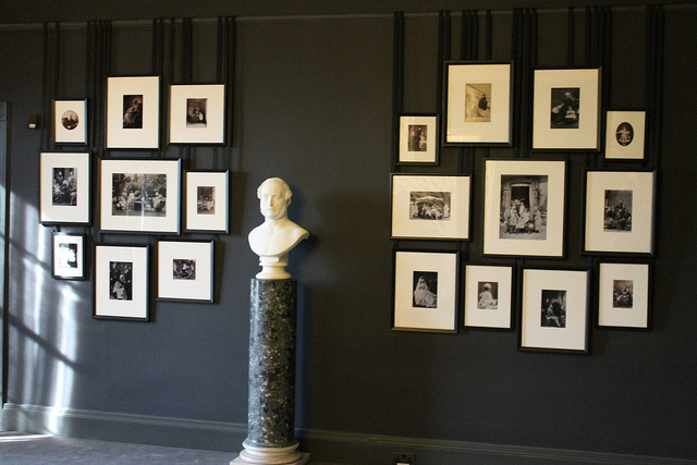 The Mourning Room, devoid of colour, still features very elegant and creative displays. Here's a bust of Albert, surrounded by family portraits and photographs
