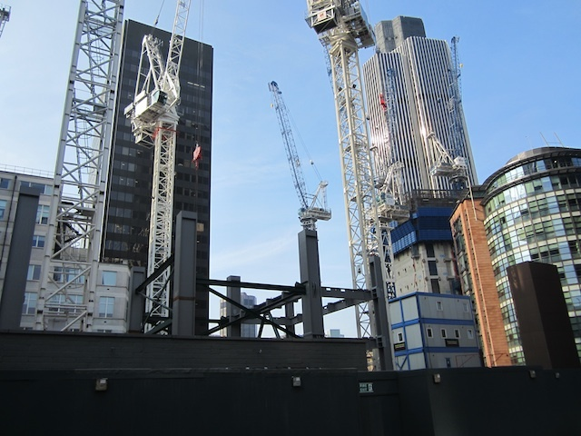 The Cheese Grater begins to rise. The stalled Pinnacle can be seen in the background.