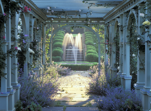 Mount Sharon garden in Orange, VA, designed by Charles Stick. The pergola and fountain in the rose garden are touched by shimmering afternoon light.