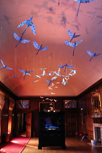 A flock of porcelain birds make up part of Coney's set design in The Queen's Gallery
